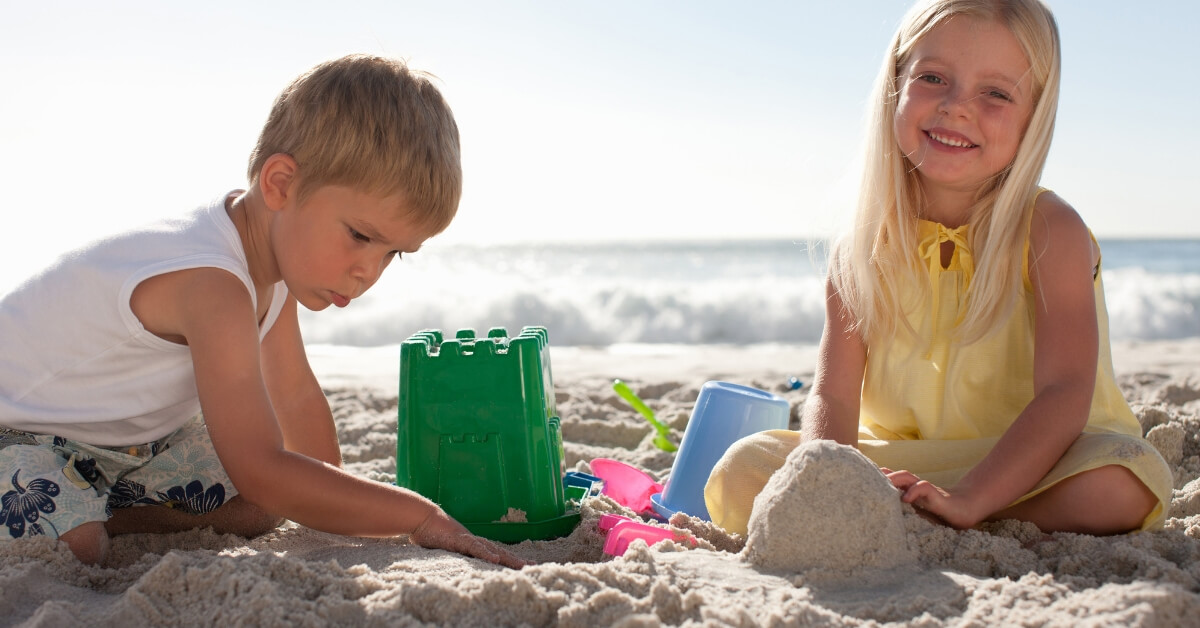 kids making sand castles on the beach