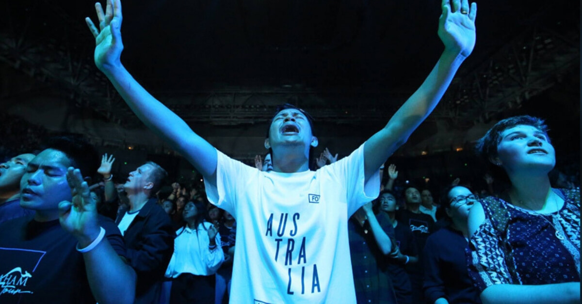 Young people pour out their hearts in worship and prayer at a packed Melbourne Arena on Saturday, February 16.