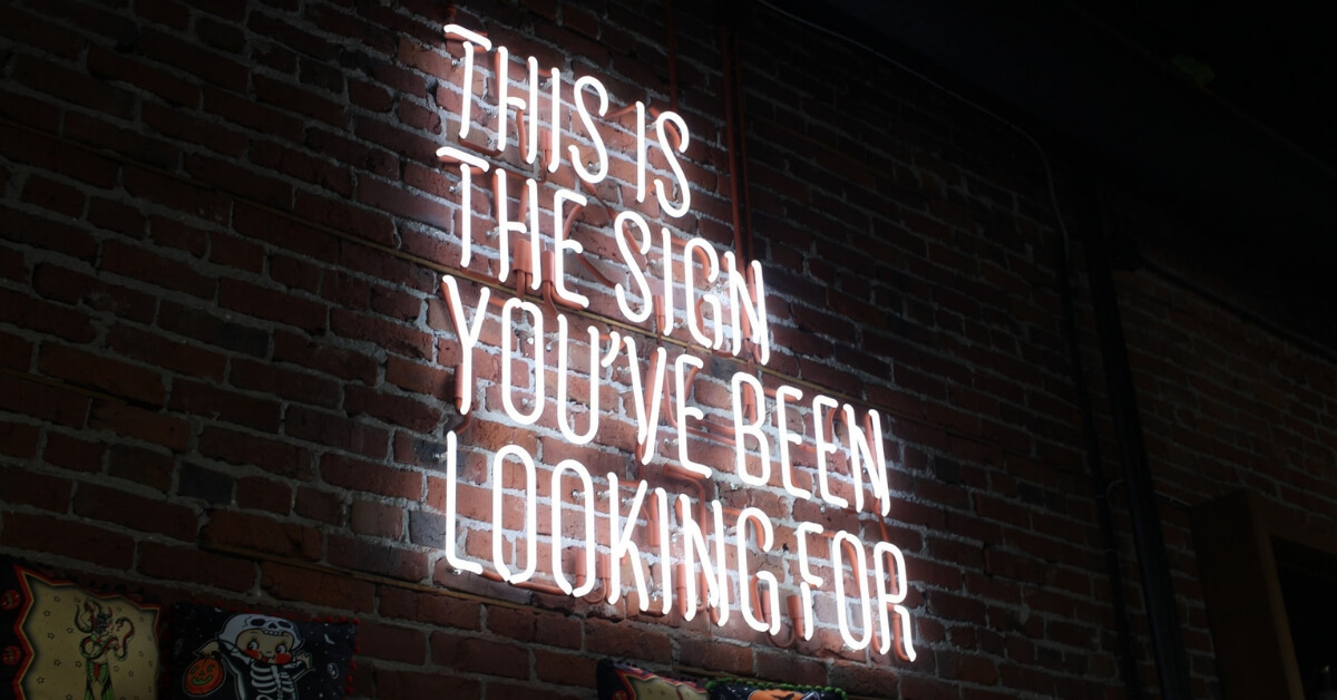 """a neon sign which says """"this is the sign you've been looking for"""""""