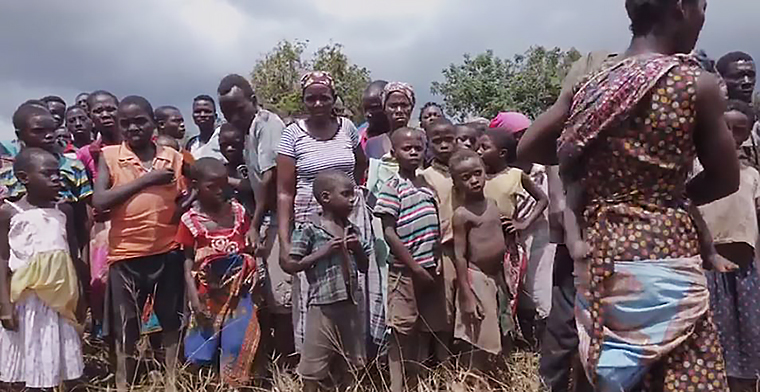 esidents of an isolated community in Beira, Mozambique gather and wait as aid is delivered by World Vision.