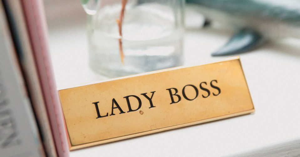 Desk with the name sign lady boss embossed in it