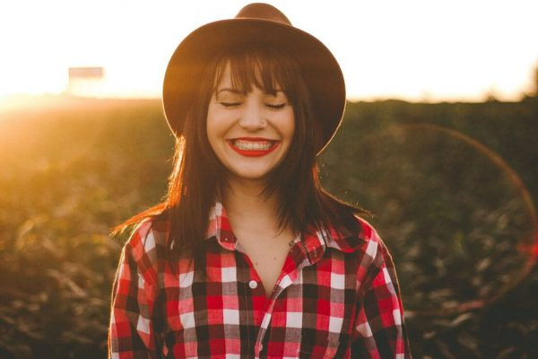 Girl smiling with hair backlit by the sun