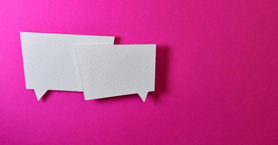 two speech bubbles on bright pink background
