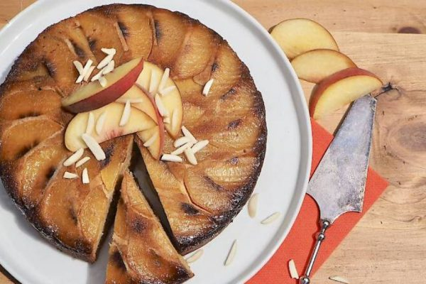 susan joy's peach upside down cake topped with peach slices