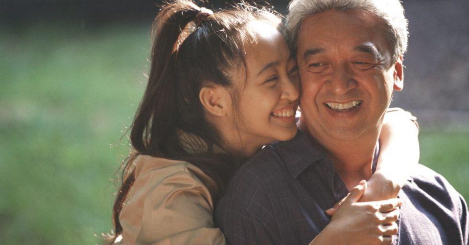 photo of a teenage girl hugging her dad