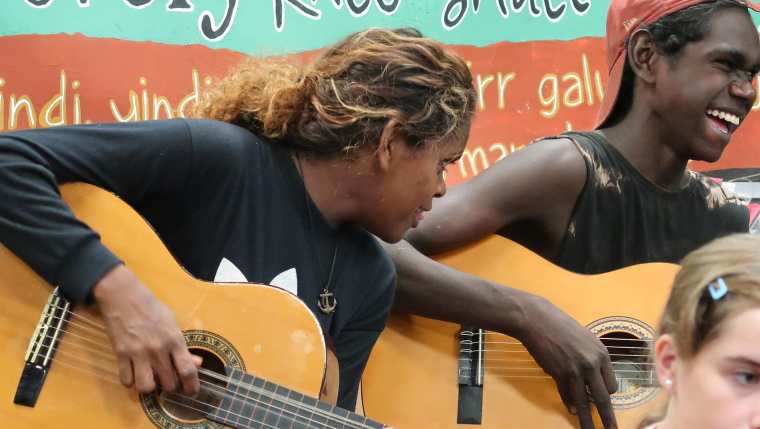 indigenous australians playing guitars