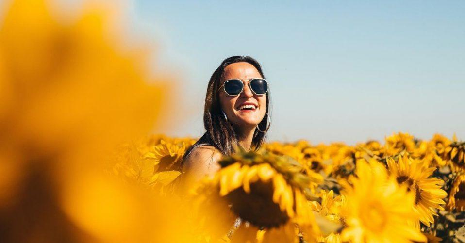 happy girl in a field of sunflowers