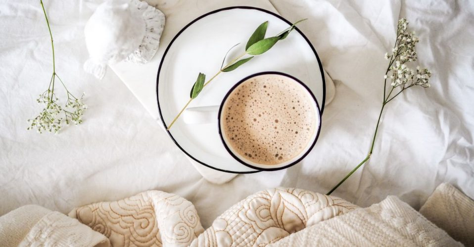 coffee on a plate on a bed