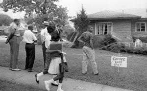 Locals view the bombed home of NAACP attorney Arthur Shores, Birmingham 1963. Marion Trikosko (public domain)